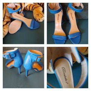 Breckelle's ankle strap blue heels